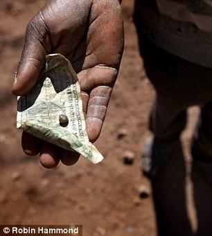 marange-stone-and-dollar-in-hand